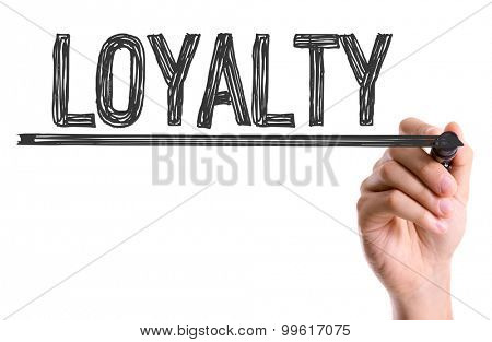Hand with marker writing the word Loyalty