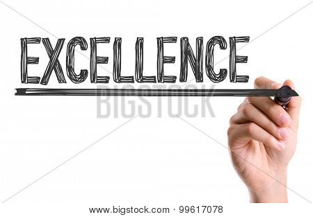 Hand with marker writing the word Excellence