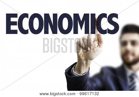 Business man pointing the text: Economics