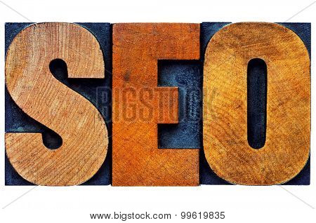 search engine optimization (SEO) - isolated word abstract  in vintage letterpress wood type printing blocks stained by color inks