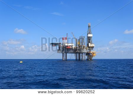 Offshore Jack Up Drilling Rig Over The Production Platform In The Middle Of The Sea View From Crew B