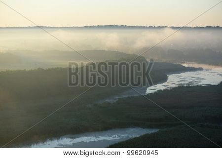 Morning landscape with fog over the river. Ukraine, Europe