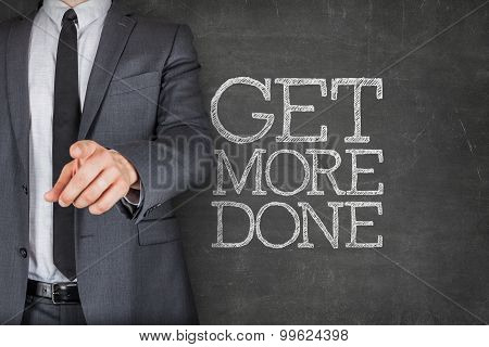 Get more done on blackboard with businessman