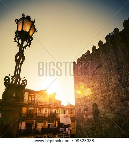 Ancient wall with lantern in the city of Porto