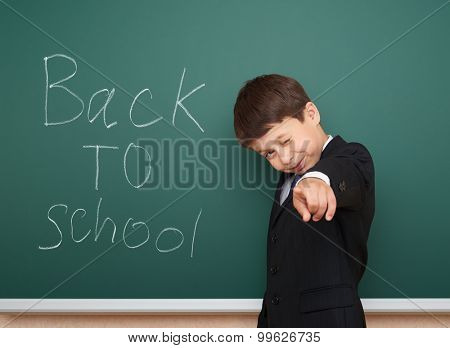 boy with back to school text on the board