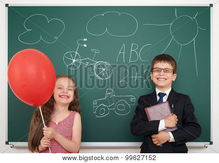 school boy and girl drawing on board