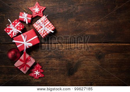 Christmas gift boxes and decoration over grunge wooden background