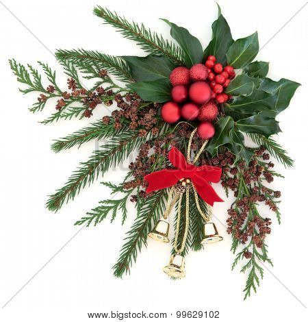 Christmas flora with gold bells and red bauble decorations with holly, ivy and winter greenery over white background.