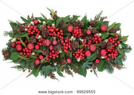 Christmas red bauble decorations, holly, mistletoe, ivy, pine cones and traditional winter greenery over white background.