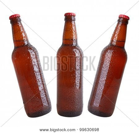 Bottles with drops isolated on white background