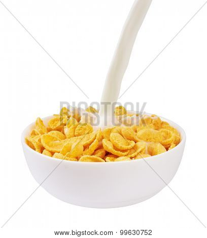 Pouring milk into corn flakes, isolated on white background