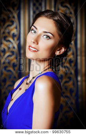 Close-up portrait of a beautiful elegant lady in vintage interior. Fashion shot.