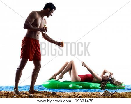 one caucasian couple man and woman drinking  on the beach silhouette isolated on white background