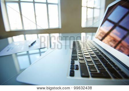 Close-up of open laptop on table