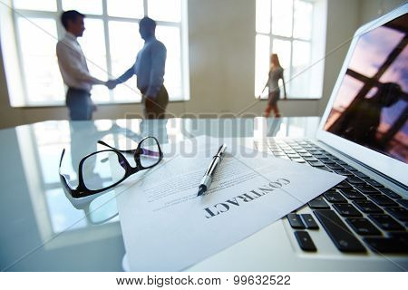 Businessmen shaking hands after conclusion of contract