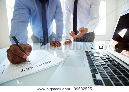 Businessman asking his lawyer to explain terms of contract