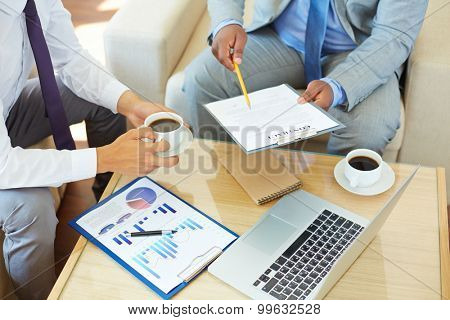 Businessman presenting contract to his partner