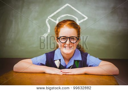 Graduation hat vector against cute little girl smiling in classroom