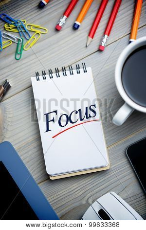 The word focus against notepad on desk