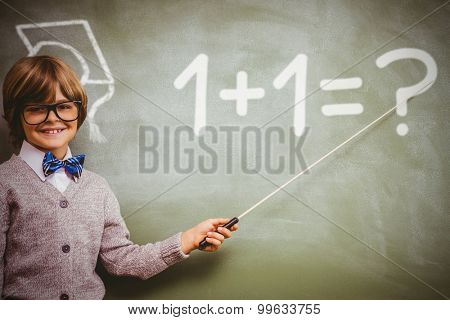 One plus one against boy holding stick in front of blackboard