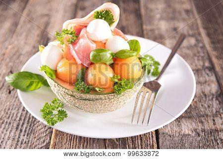 salad with melon,mozzarella and basil