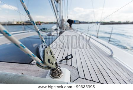 vacation, travel, cruise and leisure concept - close up of sailboat winch or yacht deck sailing on sea