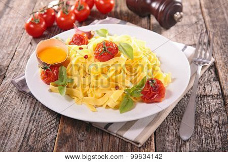 tagliattelle with baked tomato and egg