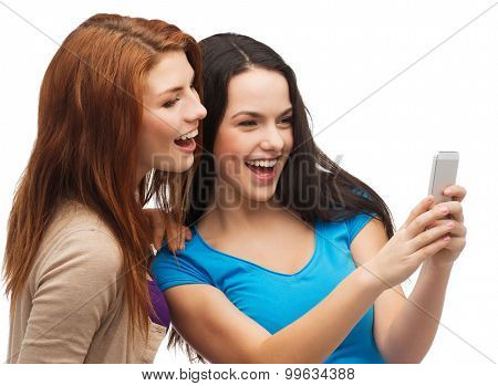 technology, friendship and people concept - two smiling teenagers with smartphone