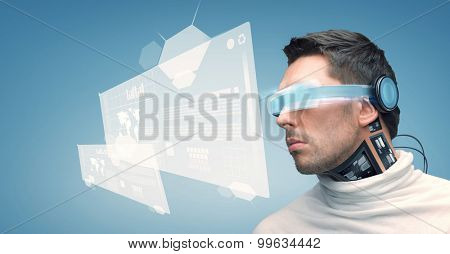 people, technology, future and progress - man with futuristic glasses and microchip implant or sensors over blue background and virtual screens