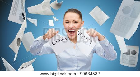 business, emotion, fail and people and concept - angry businesswoman tearing contract over blue background