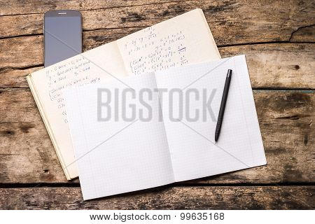 Open Notebook With Pen And Smartphone