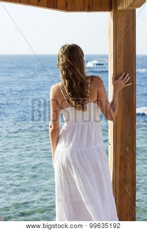 Young Woman In White Dress Watching Ship On The Sea