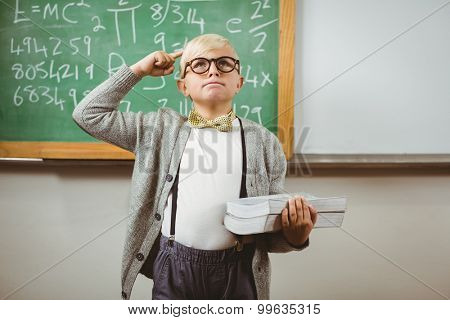 Pupil dressed up as teacher holding books in a classroom