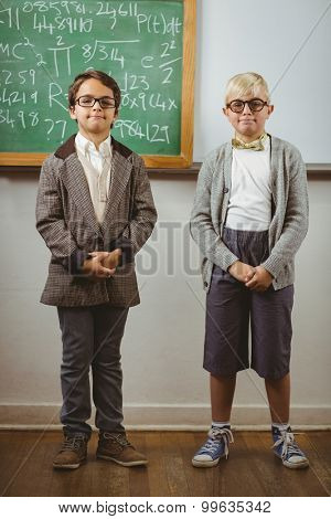 Portrait of smiling pupils dressed up as teachers in a classroom in school