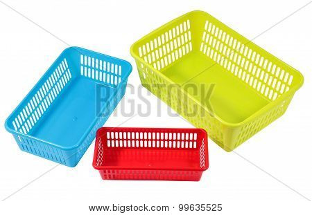 Several Small Different Colored Plastic Baskets For Household Use