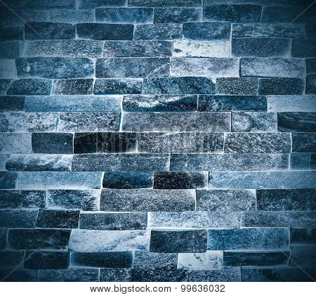 Abstract weathered texture of stained old dark stucco snowy and painted blue, black brick wall background in rural room Grungy frosty blocks of ice stonework glacial retro color architecture wallpaper