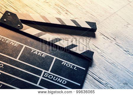 Film wooden camera chalkboard on wooden table
