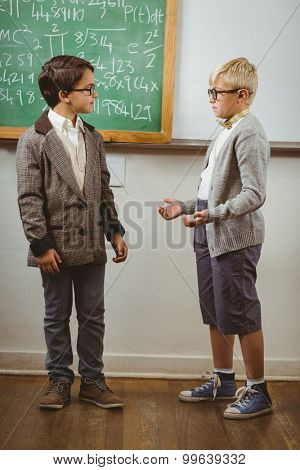 Pupils dressed up as teachers in a classroom in school