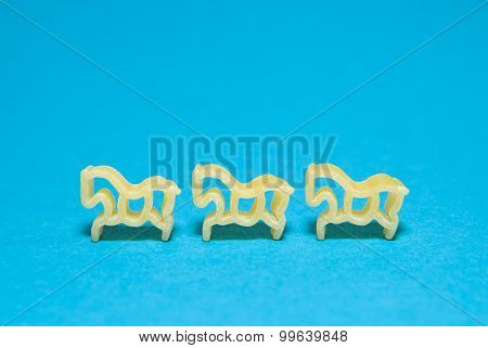Pasta In The Form Of Animals On A Blue Background