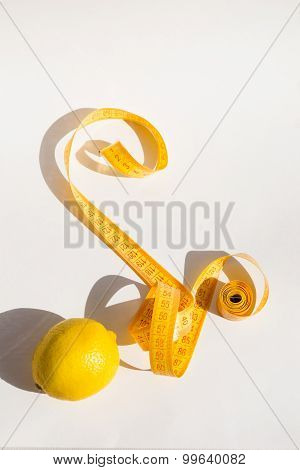 Lemon and measure tape, concept lose weight, white background
