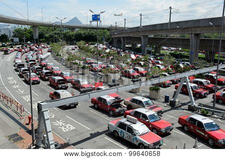 HONG KONG - JUNE 04, 2015: taxi cars in Hong Kong International Airport. Hong Kong International Airport is the main airport in Hong Kong. It is located on the island of Chek Lap Kok