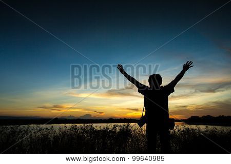 man close arms under the sunrise