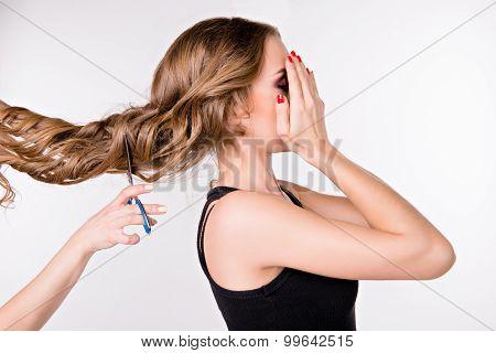 Girl Cut Long Hair. Closed Her Eyes In Fear