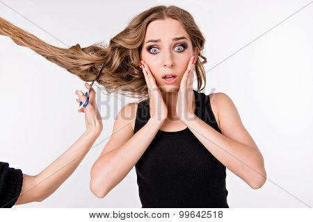 Young Woman Scared Of Cutting Her.hair