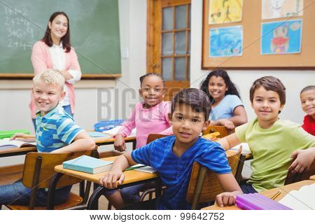 Students and teacher looking at the camera at the elementary school