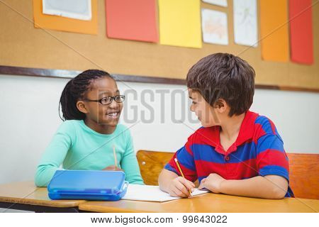 Smiling students looking at each other at the elementary school