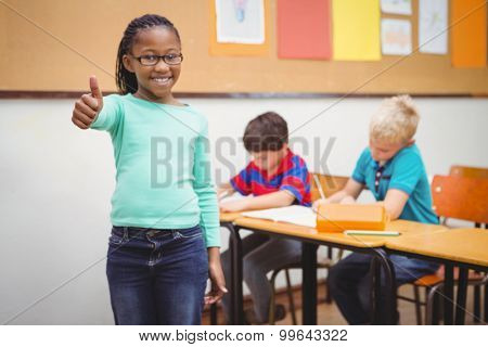 Smiling student with thumbs up at the elementary school