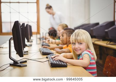 Students using computers in the classroom at the elementary school