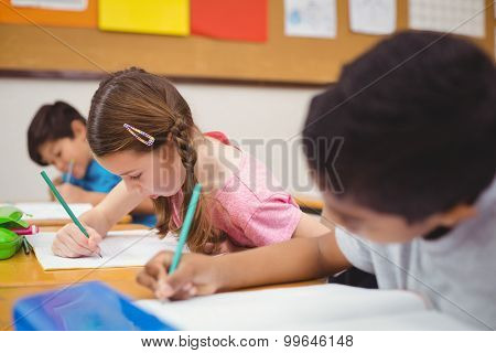 Pupil working at her desk at the elementary school