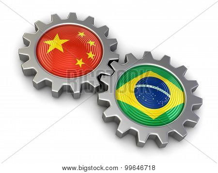 Chinese and Brazilian flags on a gears (clipping path included)